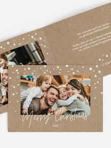 Weihnachtskarte für Ihr Business mit leuchtender Häuserfassade.