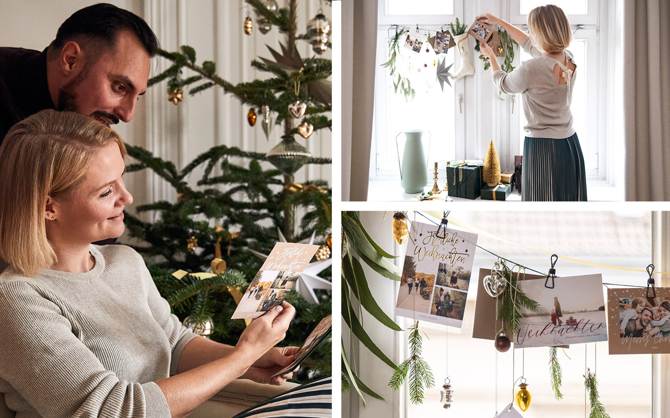 Classy Christmas, Weihnachten zu Hause, Paar hängt Weihnachtskarten auf.